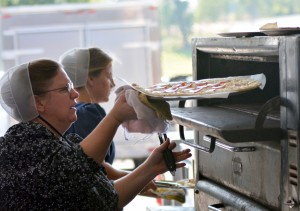Lots of food, including pizza, was available at the benefit auction for the Clinic for Special Children Saturday.